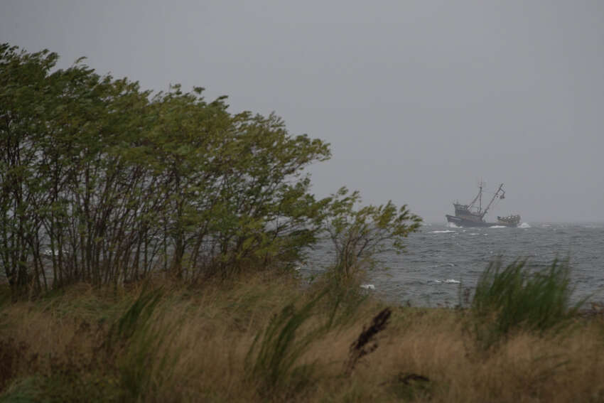 A fishing boat heads back into shore as heavy wind and rain hit the beach at Golden Gardens on Wednesday, Oct. 18, 2017. An atmospheric river is dumping a series of storms across the PNW this week, leaving inches of precipitation in the region.