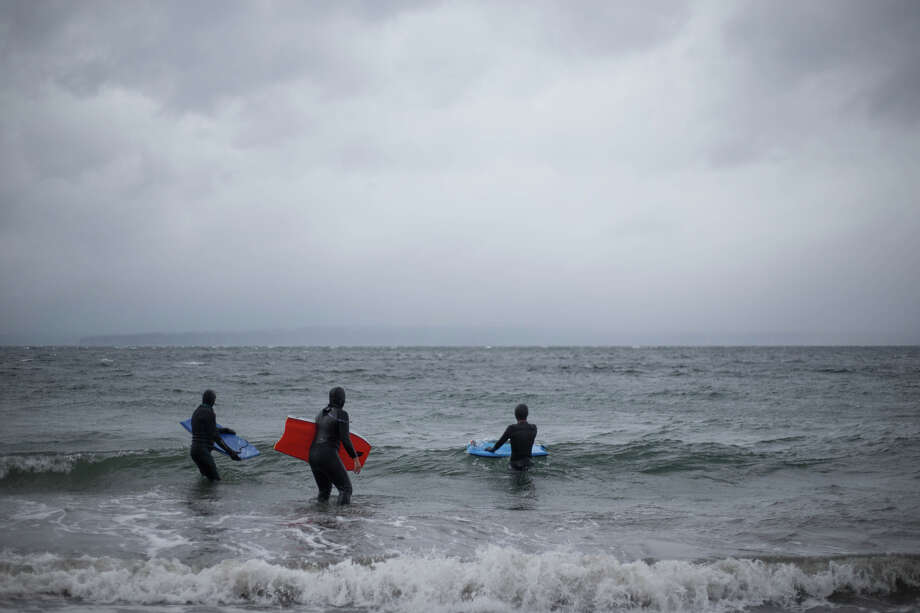 Bodyboarders enjoy the regular, easy waves as a storm rolls in at Golden Gardens on Wednesday, Oct. 18, 2017. Photo: GRANT HINDSLEY, SEATTLEPI.COM / SEATTLEPI.COM