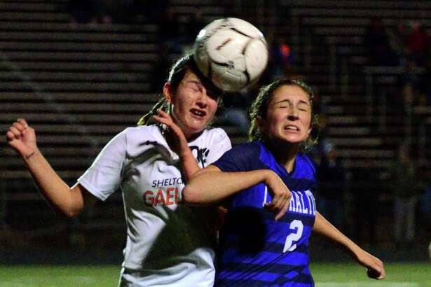 Shelton's Zoe Rogers, left, heads the ball along with Lauralton Hall's Molly Rotondo during girls soccer action in Shelton, Conn., on Wednesday Oct. 18, 2017.