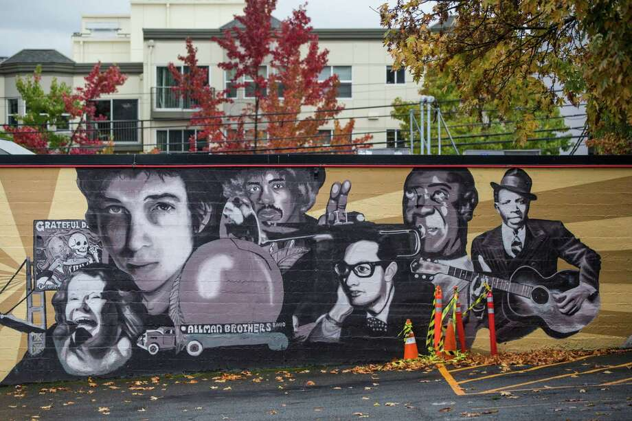 A mural of influential musicians is seen on the north side of the Seattle Immersive Theatre/Silver Platters building at 5th Ave N and Roy St, on Wednesday, Oct. 18, 2017. The building, and mural, are slated for demolition to takeaway for an apartment building before the end of the year. Photo: GRANT HINDSLEY, SEATTLEPI.COM / SEATTLEPI.COM