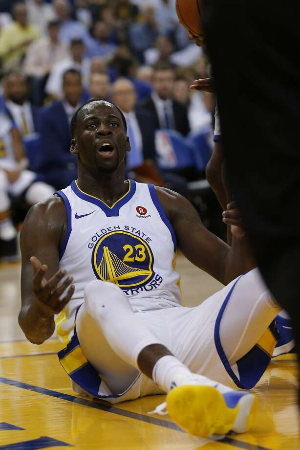 Golden State Warriors forward Draymond Green (23) calls for a foul during the third quarter of an NBA game between the Golden State Warriors and the Houston Rockets at Oracle Arena on Tuesday, Oct. 17, 2017, in Oakland, Calif. Green was later taken out of the basketball game because of an injury. Photo: Santiago Mejia, The Chronicle