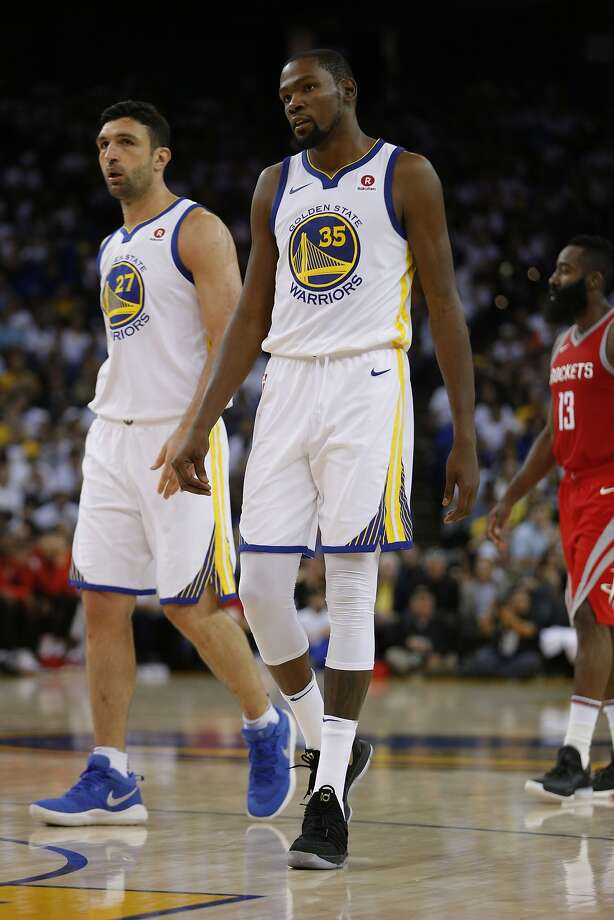 Golden State Warriors forward Kevin Durant (35) and center Zaza Pachulia (27) react as Houston Rockets guard James Harden (13) is in the background during the third quarter of an NBA game between the Golden State Warriors and the Houston Rockets at Oracle Arena on Tuesday, Oct. 17, 2017. Photo: Santiago Mejia, The Chronicle