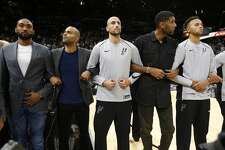 Spurs' players - current and former - including Tony Parker (second from left), Manu Ginobili, Tim Duncan and Kyle Anderson stand together with arms interlocked before the season opener against the Minnesota Timberwolves at the AT&T Center on Wednesday, Oct. 18, 2017. (Kin Man Hui/San Antonio Express-News)