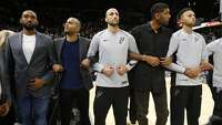 Spurs link arms for National Anthem before season opener - Photo