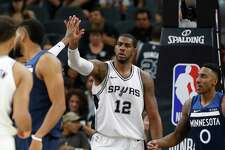 Spurs' LaMarcus Aldridge (12) gets high-fives after a score on a foul against the Minnesota Timberwolves at the AT&T Center on Wednesday, Oct. 18, 2017.