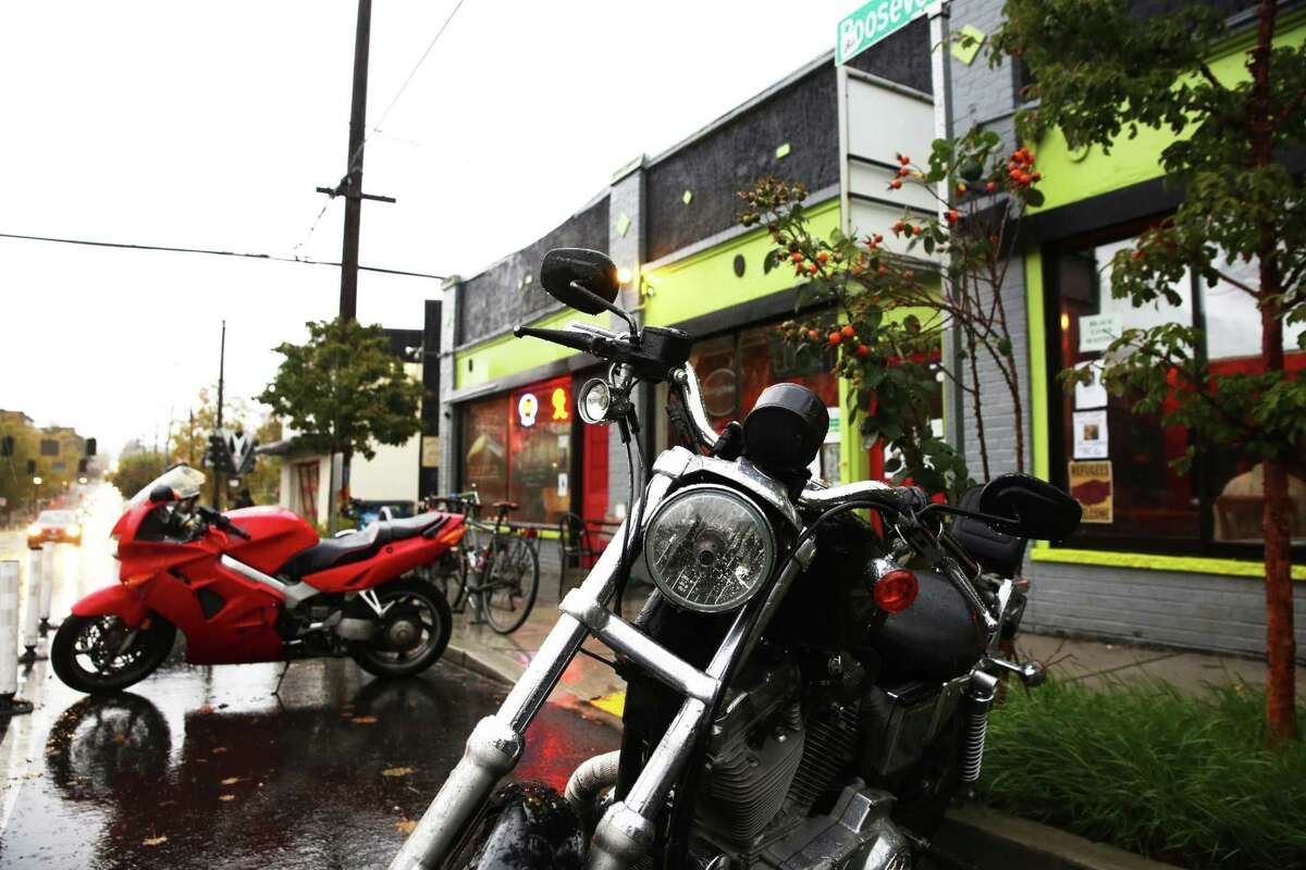 Motorcycles are parked in front of Cafe Racer on the restaurant's last night in business, Wednesday, October 18, 2017.
