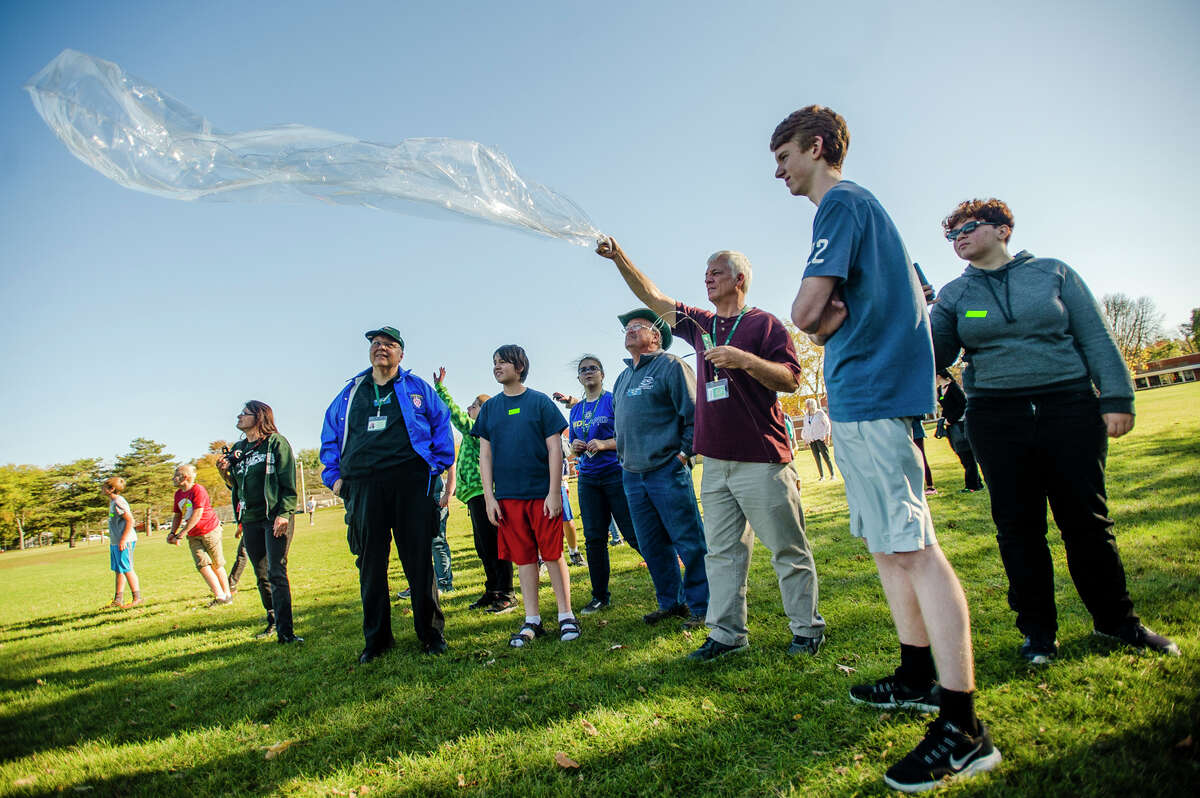 A weather balloon with instruments that will record data is released on Wednesday, Oct. 18, 2017 at Northeast Middle School. (Katy Kildee/kkildee@mdn.net)