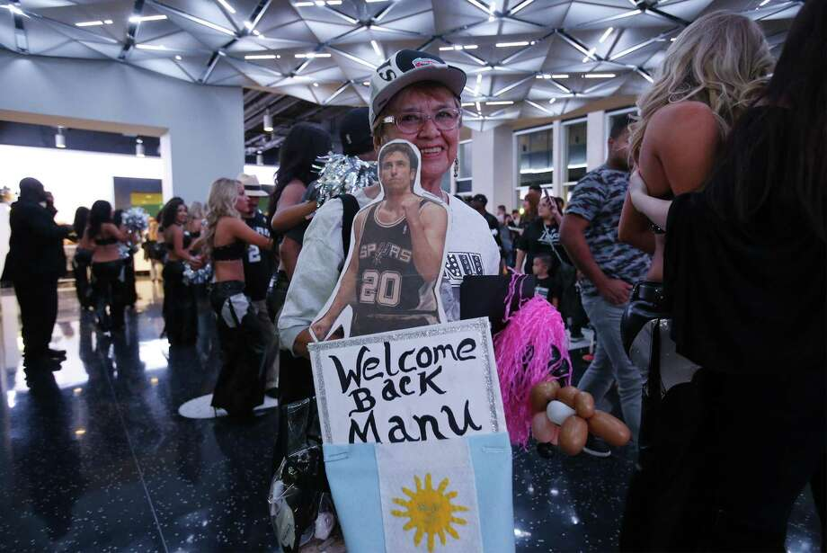 Spurs fan Mary Lou Rodriguez carries her homemade signs to welcome back the team - especially Manu Ginobili - before Spurs against Minnesota Timberwolves season opener at the AT&T Center on Wednesday, Oct. 18, 2017. (Kin Man Hui/San Antonio Express-News) Photo: Kin Man Hui, Staff / San Antonio Express-News / ©2017 San Antonio Express-News