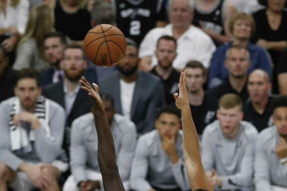 Spurs' Joffrey Lauvergne (77) attempts a shot against Minnesota Timberwolves' Gorgui Dieng (05) at the AT&T Center on Wednesday, Oct. 18, 2017. (Kin Man Hui/San Antonio Express-News)