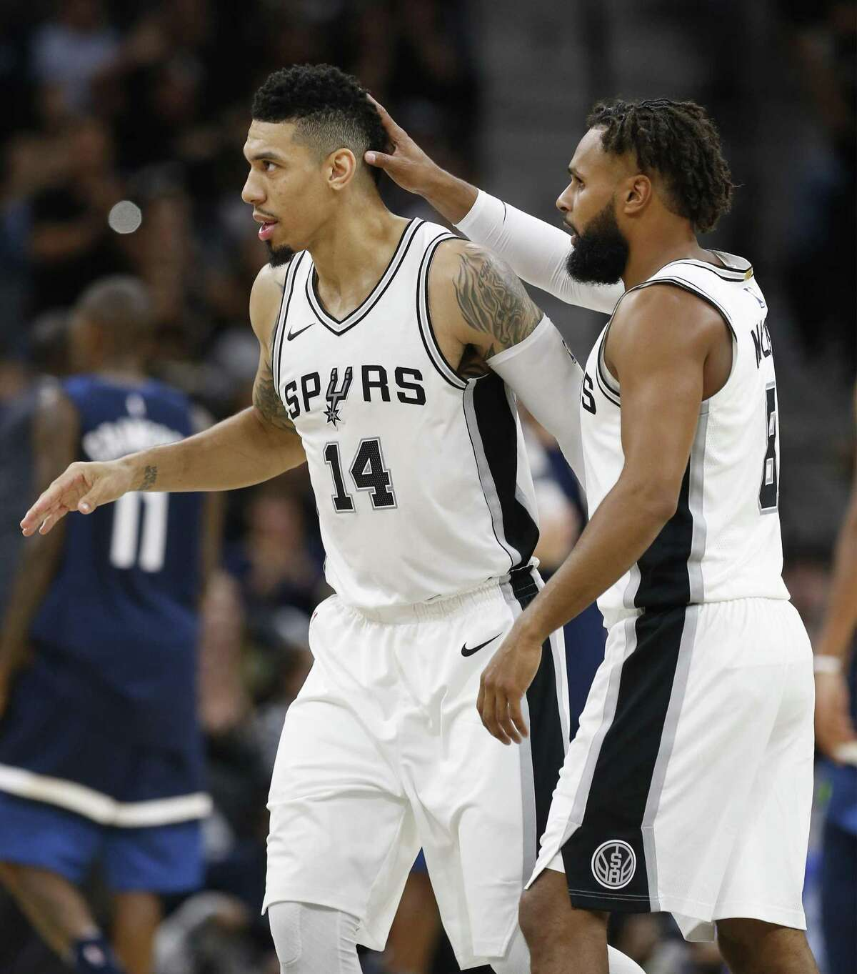 Spurs' Patty Mills (08) congratulates teammate Danny Green (14) after Green hit a three-pointer in the fourth against the Minnesota Timberwolves at the AT&T Center on Wednesday, Oct. 18, 2017. Spurs defeated the T'Wolves, 107-99. (Kin Man Hui/San Antonio Express-News)