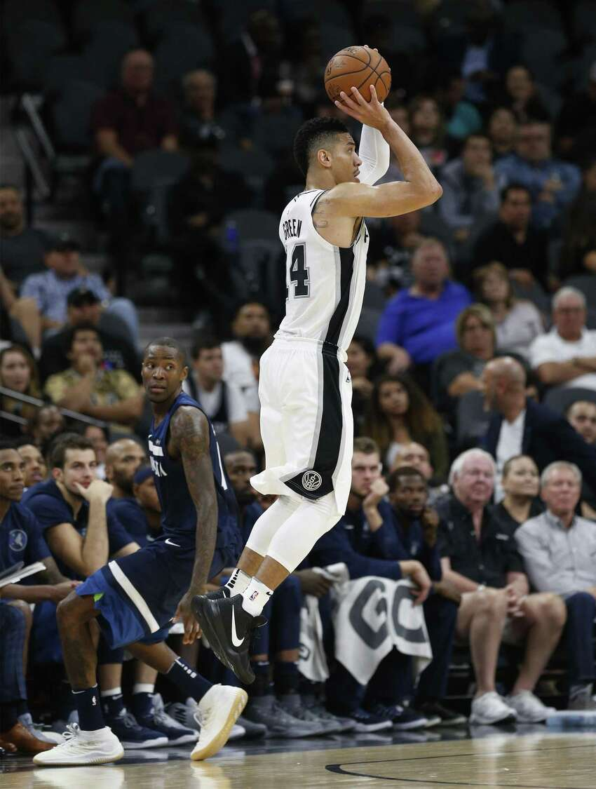 Spurs' Danny Green (14) shoots another three-pointer against Minnesota Timberwolves' Jamal Crawford (11) in the fourth at the AT&T Center on Wednesday, Oct. 18, 2017. Spurs defeated the T'Wolves, 107-99. (Kin Man Hui/San Antonio Express-News)