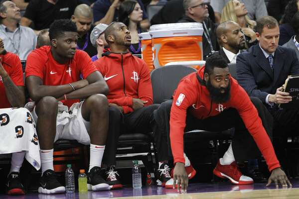 Houston Rockets' Clint Capela, Chris Paul and James Harden, from left, watch during the second half of the team's NBA basketball game against the Sacramento Kings in Sacramento, Calif., Wednesday, Oct. 18, 2017. The Rockets won 105-100. (AP Photo/Steve Yeater)