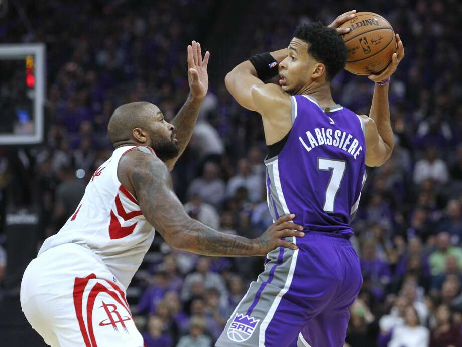 Sacramento Kings forward Skal Labissiere (7) looks for an opening against Houston Rockets defender P.J. Tucker (4) during the second half of an NBA basketball game in Sacramento, Calif., Wednesday, Oct. 18, 2017. The Rockets won 105-100. (AP Photo/Steve Yeater) Photo: Steve Yeater/Associated Press