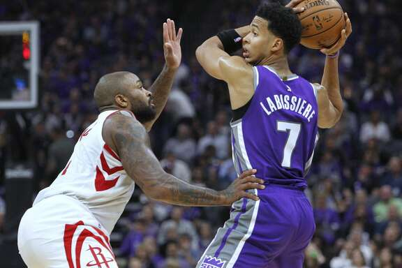 Sacramento Kings forward Skal Labissiere (7) looks for an opening against Houston Rockets defender P.J. Tucker (4) during the second half of an NBA basketball game in Sacramento, Calif., Wednesday, Oct. 18, 2017. The Rockets won 105-100. (AP Photo/Steve Yeater)