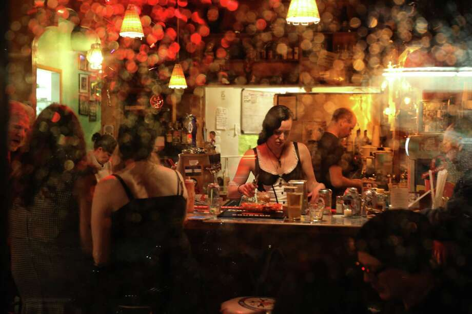 Patrons fill at Cafe Racer on its last night in business, Oct. 18, 2017. Owner Kurt Geissel announced Monday that the bar would be closing this week after 14 years.  Cafe racer was the scene of a mass shooting five years ago, in which four people were killed. Photo: GENNA MARTIN,  SEATTLEPI / SEATTLEPI.COM