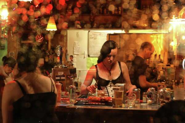Patrons fill at Cafe Racer on its last night in business, Oct. 18, 2017. Owner Kurt Geissel announced Monday that the bar would be closing this week after 14 years.  Cafe racer was the scene of a mass shooting five years ago, in which four people were killed.