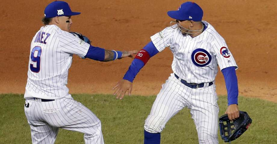 Chicago Cubs second baseman Javier Baez (9) and left fielder Jon Jay celebrate the team's 3-2 win over the Los Angeles Dodgers in Game 4 of baseball's National League Championship Series, Wednesday, Oct. 18, 2017, at Wrigley Field in Chicago. (Steve Lundy/Daily Herald via AP) Photo: Steve Lundy/Associated Press
