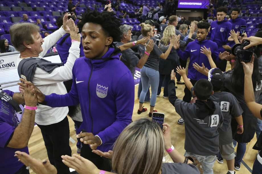 Sacramento Kings rookie guard De'Aaron Fox, left, is greeted by fans before their NBA basketball game against the Houston Rockets in Sacramento, Calif., Wednesday, Oct. 18, 2017. (AP Photo/Steve Yeater) Photo: Steve Yeater/Associated Press