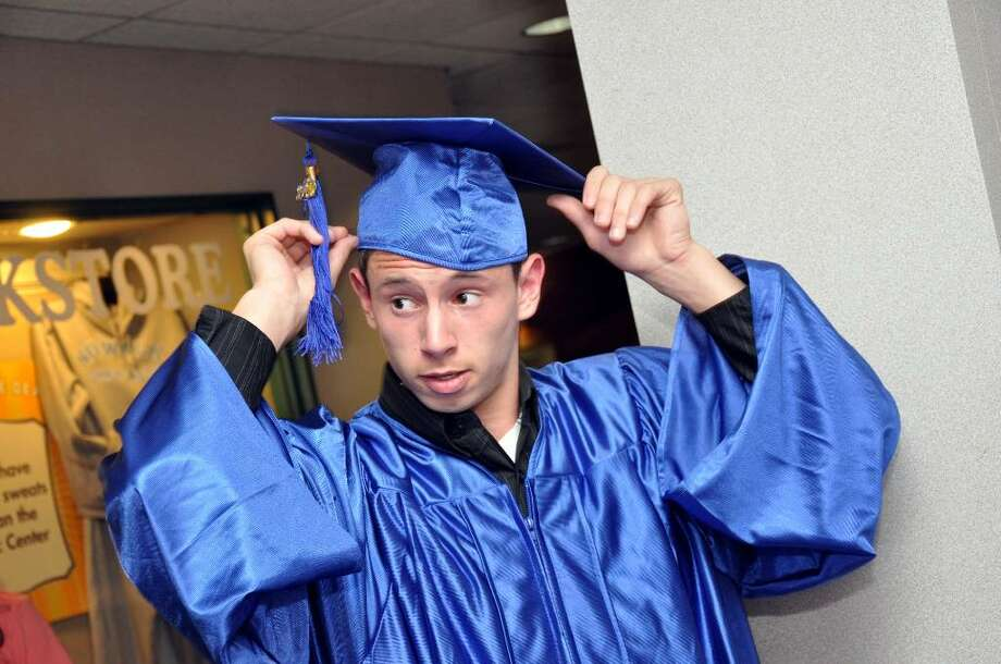 Rory Klein fixes his cap before the Richard C. Briggs High School graduation ceremony at the Pepsico Theater at Norwalk Community College on Wednesday, June 23, 2010. Photo: Amy Mortensen / Connecticut Post Freelance