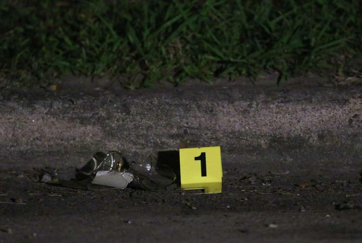 Houston Police investigates a scene where three suspects fatally shot a man on the 200 block of Casa Grande Drive Thursday, Oct. 19, 2017, in Houston.