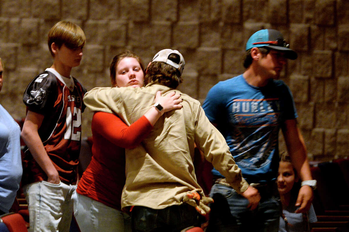 Mourners hug before a vigil at Silsbee High School for Ashley Pickering and her five children, who were killed in a house fire on Wednesday. Photo taken Wednesday 10/18/17 Ryan Pelham/The Enterprise