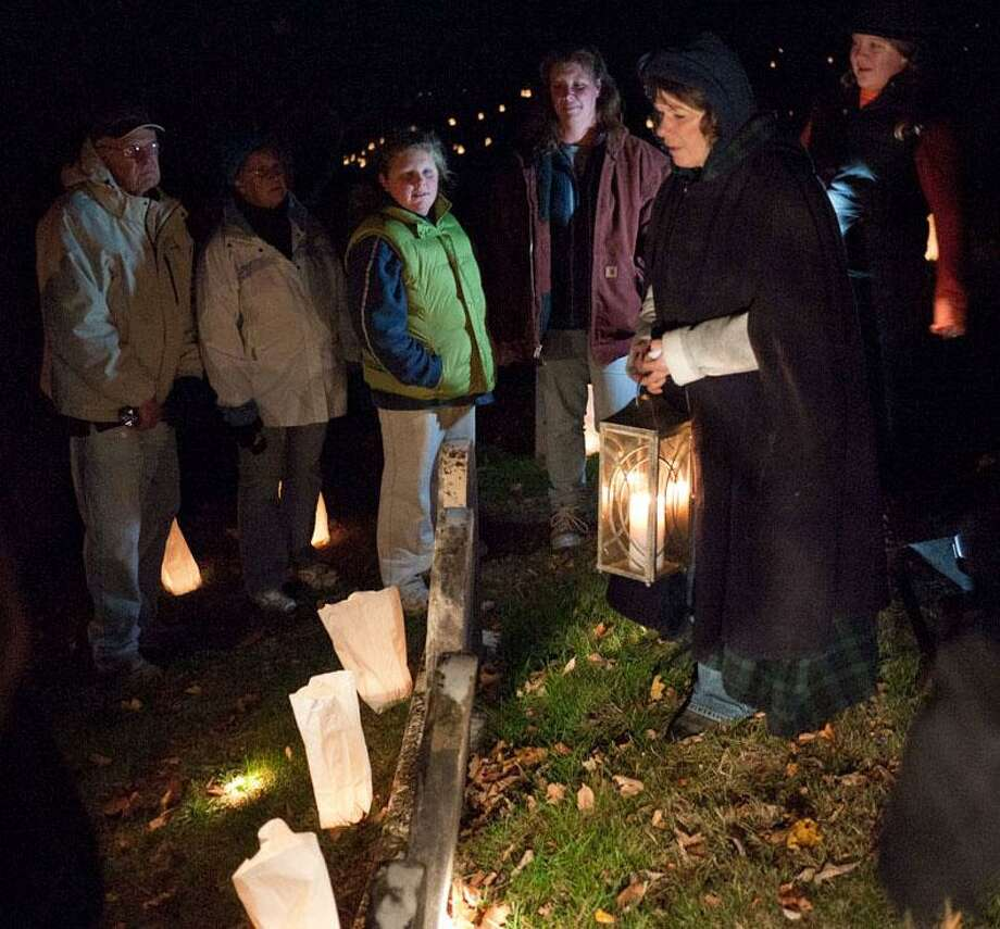 The Gunn Historical Museum in Washington will hold its 10th annual Washington Green Cemetery Tour Oct. 27 from 6:30 to 8:30 p.m. A rain date of Oct. 29 is planned. Groups of visitors will be led by tour guides dressed in vintage attire along a path of 1,000 luminaries through the cemetery to meet some of Washingtons unforgettable residents from the past. Photo: Courtesy Of Gunn Historical Museum / The News-Times Contributed