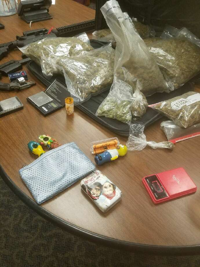 Fire arms and hydroponic marijuana were seized from a Port Arthur home during an October 18, 2017 search warrant, according to the Jefferson County Sheriff's Office. Photos: JCSO Photo: Photos: JCSO