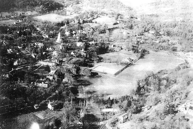 """Airplanes helped change the way we travel from place to place during the early years of the 20th century and, as depicted in this photograph, how we view the places we live. This aerial photograph of the Washington Green section of town shows much of the Gunnery School campus and reveals just how tucked the village of Washington has been amongst the Litchfield County Hills. If you have a """"Way Back When"""" photograph to share, contact Deborah Rose at drose@newstimes.com or 860-355-7324."""