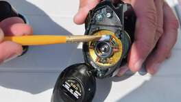 A good coating of grease lightly brushed onto the inside of a fishing reel used in saltwater angling will go a long way toward keeping the gear in good working order, according to veteran Guide Scott Hibbetts.