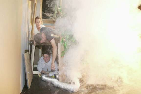"""""""Sleuth"""" director Amber Fabian of Friendswood, top, actor Chris Lowe and special effects specialist John Zipay, another Friendswood resident,  try out one of the effects in the mystery, which runs through Oct. 27 at Bay Area Harbour Playhouse in Dickinson."""