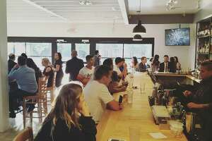Spring Street Beer and Wine Garden features 14 taps, 25 wines, cocktails and a unique ownership model.