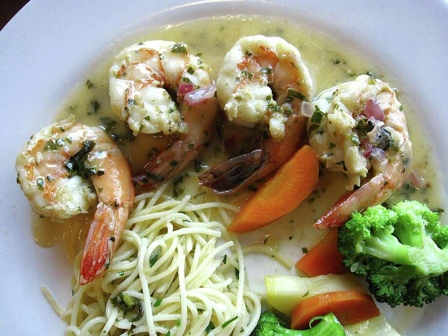Shrimp in white wine and lemon sauce from Aldino at The Vineyard. Photo: Mike Sutter /San Antonio Express-News