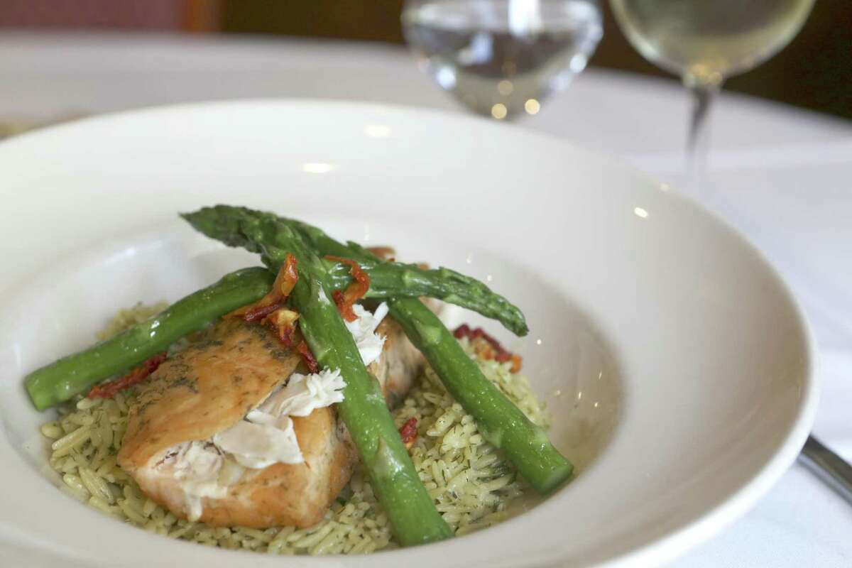 Salmon and crab with asparagus over orzo with lemon an white wine sauce from Aldino at The Vineyard.
