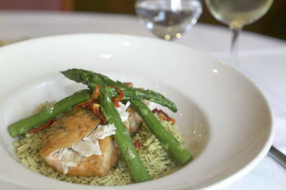 Salmon and crab with asparagus over orzo with lemon an white wine sauce from Aldino at The Vineyard. Photo: William Luther /San Antonio Express-News / © 2017 San Antonio Express-News