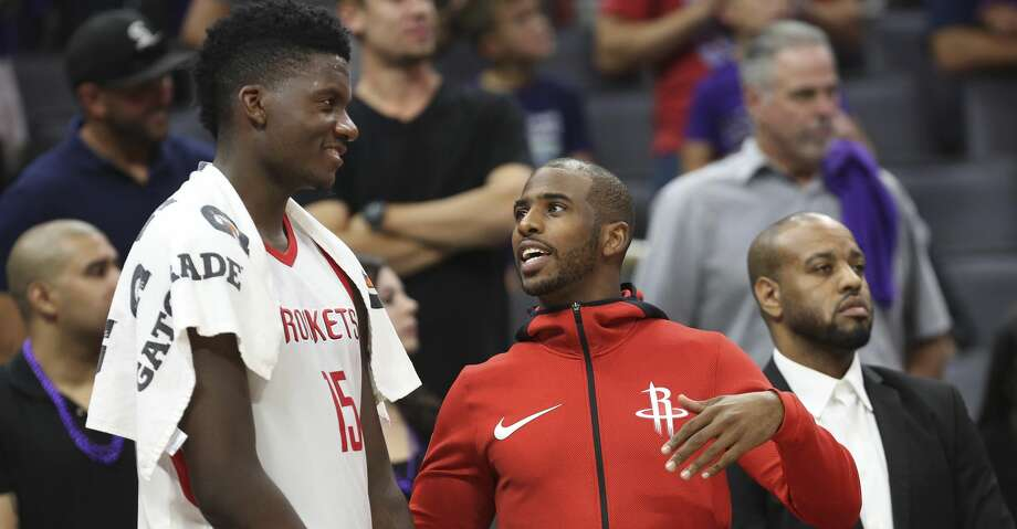 PHOTOS: Rockets 105, Kings 100Houston Rockets center Clint Capela (15) and guard Chris Paul talk on the sideline during the second half of an NBA basketball game against the Sacramento Kings in Sacramento, Calif., Wednesday, Oct. 18, 2017. The Rockets won 105-100. (AP Photo/Steve Yeater)Browse through the photos to see action from the Rockets' win over the Kings on Wednesday night. Photo: Steve Yeater/Associated Press