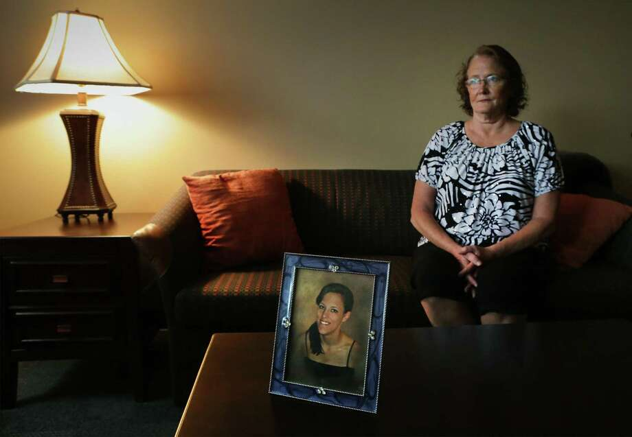 Julie Cavlovic sits near a photo of her daughter Kimbra Cavlovic who died from heroin use two years ago at the age of 21,  on Friday, Sept. 22, 2017. Photo: Bob Owen, Staff / San Antonio Express-News / ©2017 San Antonio Express-News