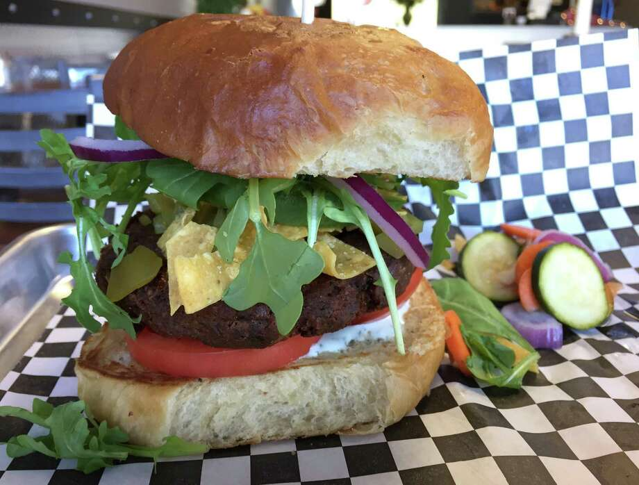 The Hatch Chickpea Veggie Burger at Benjie's Munch is one of several vegan options on the menu. Photo: Paul Stephen / San Antonio Express-News