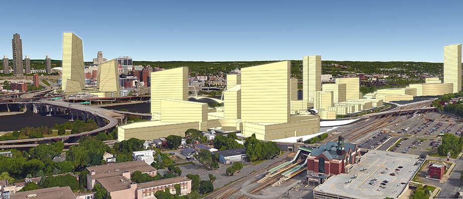 A view of Amazon in Rensselaer, with the train station in the foreground, and in Albany, at the former convention center site, background. (Dalpos Architects & Integrators, Syracuse)