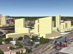 Looking west, with the Rensselaer rail station in the foreground and the Empire State Plaza in the background. Amazon would occupy space on the Rensselaer waterfront as well as vacant land originally set aside for the downtown Albany convention center. (Dalpos Architects & Integrators, Syracuse)