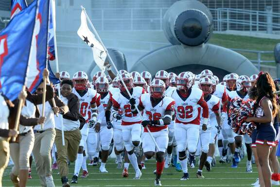 The Lamar Texans take the field before the start of a high school football game against the Westside Wolves on October 7, 2017 at Delmar Stadium, Houston, TX.