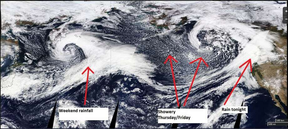A satellite image from early Thursday shows several weather systems moving across the Pacific toward the Pacific Northwest. Photo: National Weather Service