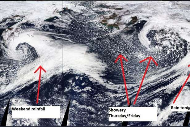 A satellite image from early Thursday shows several weather systems moving across the Pacific toward the Pacific Northwest.