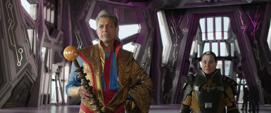 """Jeff Goldblum (left) and Rachel House in """"Thor: Ragnarok,"""" in which Goldblum plays the Grandmaster, a games-obsessed immortal being who rules a planet. Photo: Marvel Studios"""