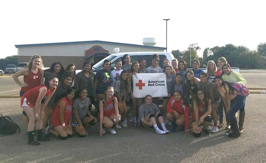 Plainview High School Lady Dog volleyball team members gather following practice Wednesday to donate $525 to the American Red Cross for disaster relief. After seeing reports of the devastation caused by Hurricane Harvey and other storms, team members wanted to their part to alleviate the supporting. As a result, on Oct. 10 during the Lady Dogs' home games against Dumas High School, the girls went through the stands passing buckets collecting cash donations. All proceeds from concession stand sales during the varsity game were also donated. The Plainview High Volleyball/Basketball Booster Club matched those sales, resulting in a total donation to the Red Cross of $525. Shown are members of the Lady Dog varsity, junior varsity and freshmen teams, coaches and a Red Cross representative.