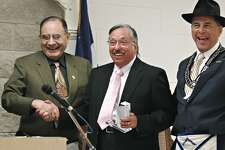 In this February 2010 file photo, Joe Trevino, left, congratulates Odie Arambula for receiving the Laredo Mason Lodge Community Builder Award.