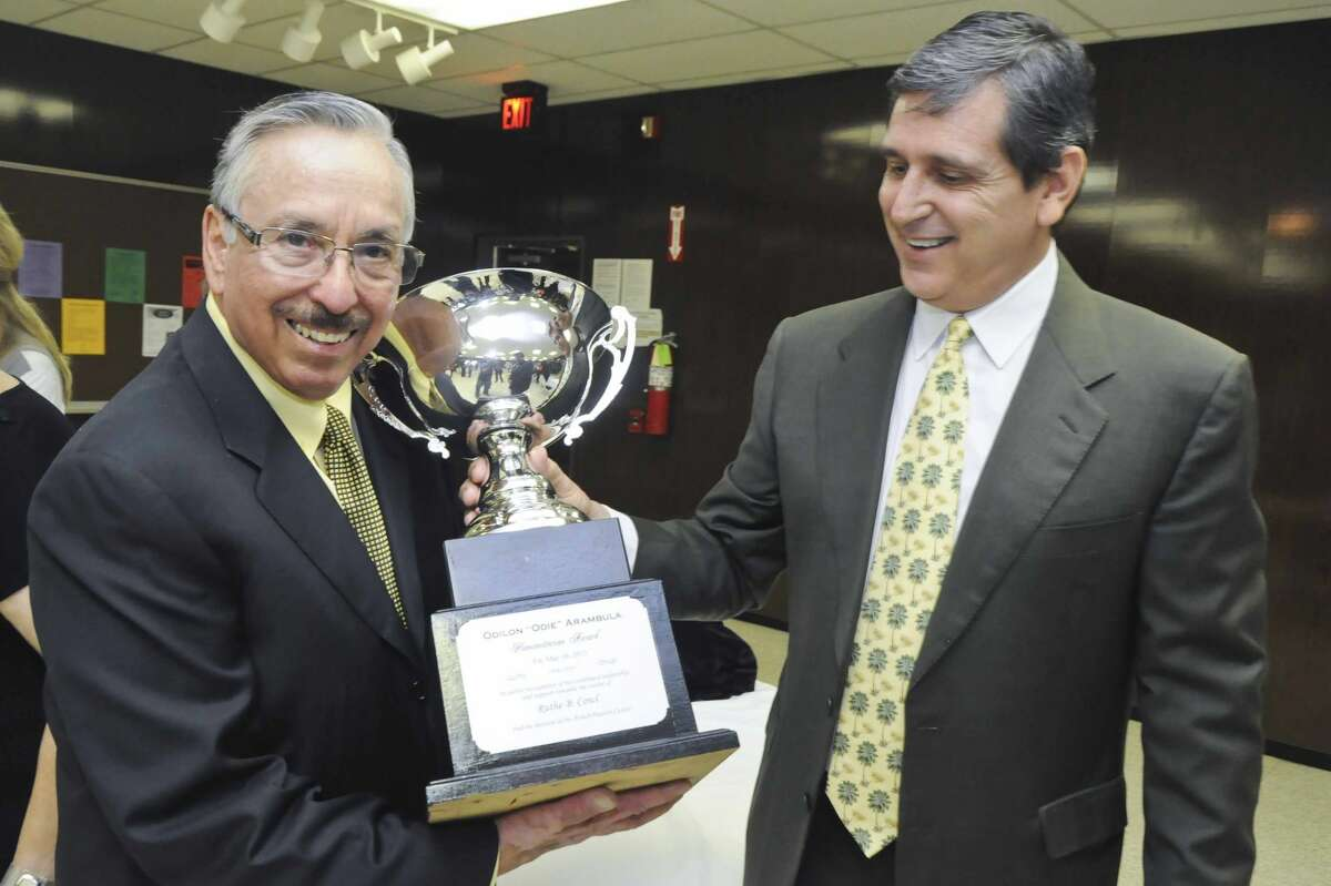 Odie Arambula, left, receives a humanitarian award in May 2013 from the Ruthe B. Cowl Rehabilitation Center.