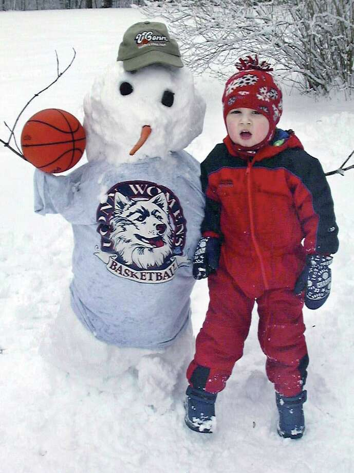 Bryce Fleck, 3, if Middlefield shoes his allegiance to UConn at his Rockfall home on Friday. .....Contributed photo by Jeri Fleck.............in TW's folder...........031904 Photo: Middletown Press File Photo