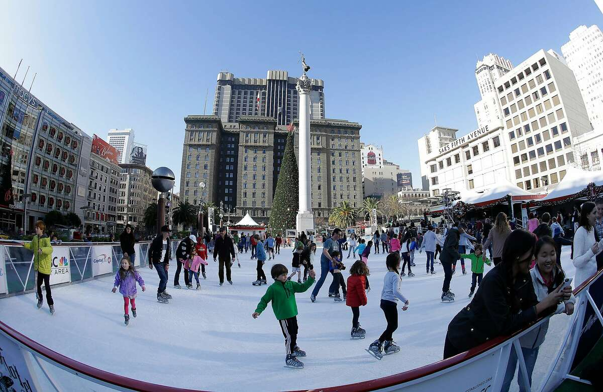 In this photo taken with a fisheye lens, skaters use the Union Square Holiday Ice Rink in San Francisco, Tuesday, Dec. 24, 2013. (AP Photo/Jeff Chiu)