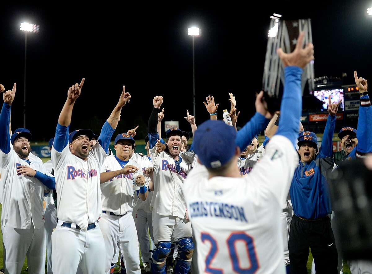 RockHounds manager Ryan Christenson presents his team with the Texas League trophy after beating Northwest Arkansas in the Texas League Championship series on Friday, Sept. 16, 2016 at Security Bank Ballpark. James Durbin/Reporter-Telegram