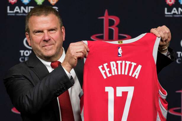 Houston Rockets owner Tilman Fertitta holds up a Rockets jersey during a news conference introducing him as the Rockets new owner at Toyota Center on Tuesday, Oct. 10, 2017, in Houston. ( Brett Coomer / Houston Chronicle )